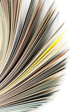 Close-up of magazine pages on white background. Shallow DOF, focus on edges. photo