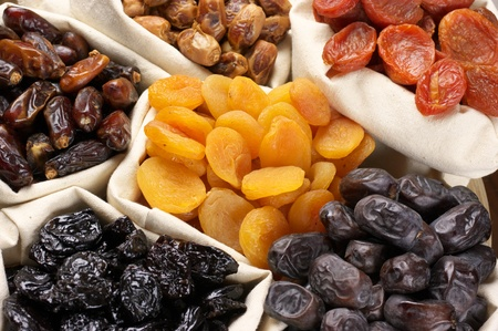 Assorted dried fruits in bags. photo