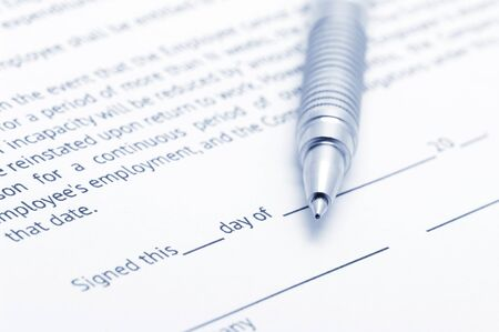 Close-up of silver pen on employment agreement. Selective focus on top of pen. Toned image. Stock Photo - 13397864