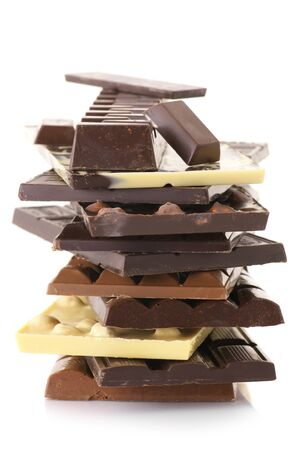 Stack of assorted chocolate bars isolated on white background. photo