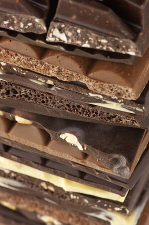 Close-up of stacked assorted chocolate. photo