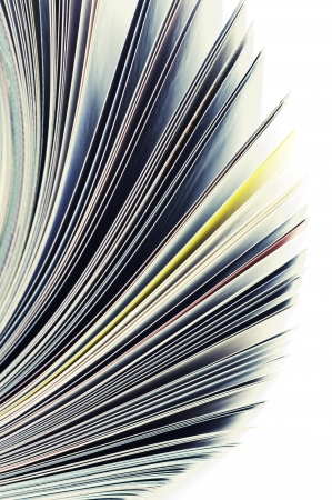 Close-up of magazine pages on white background. Shallow DOF, focus on edges. Reklamní fotografie