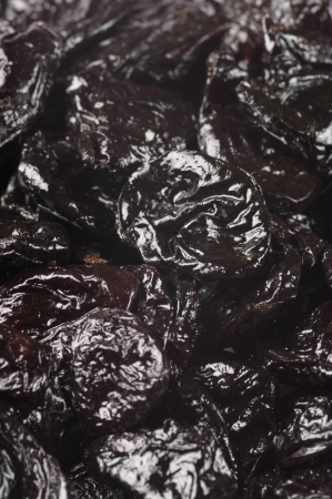 Heap of dried prunes close-up. photo