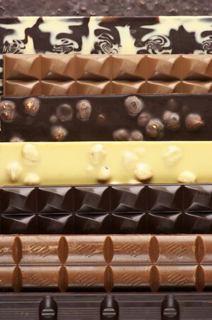 Pile of assorted chocolate bars close-up. photo