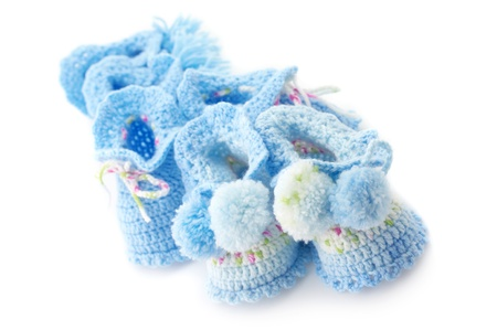 baby's bootee: Various handmade babys bootees isolated on white background.