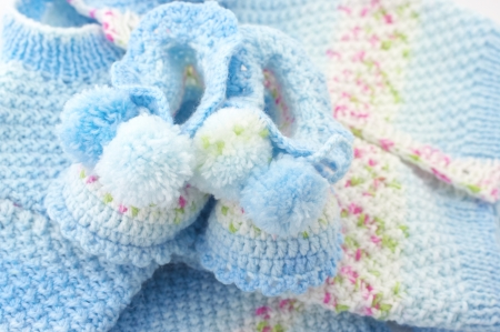 Handmade babys knitted clothes close-up.