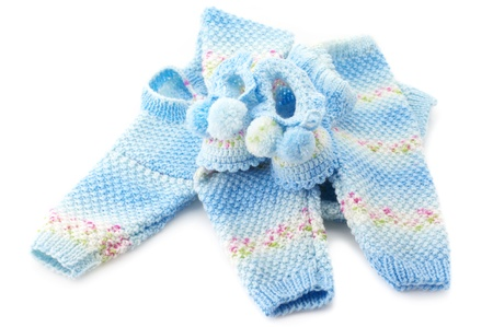 baby's bootee: Handmade babys knitted clothes isolated on white background. Stock Photo