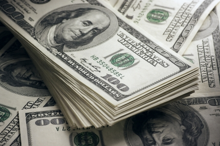 abundance money: Stack of one hundred dollar bills close-up.