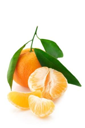 orange peel: Fresh whole tangerine and slices isolated on white background. Stock Photo