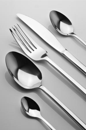fork knife: Set of steel fork, knife and spoons. B&W image.