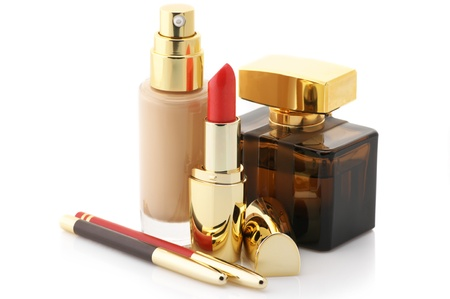 Cosmetic foundation, lipstick, pencils and perfume isolated on white background. Stock Photo