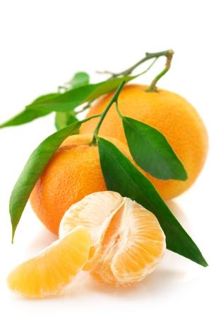 tangerine peel: Fresh whole tangerines and slices isolated on white background. Stock Photo