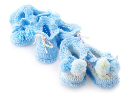 Various handmade baby's bootees isolated on white background. photo