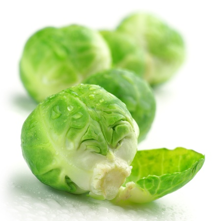 Fresh wet brussel sprouts isolated on white background.