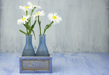 Daisy Bouquet In Vase On Grunge Background Stock Photo Picture And