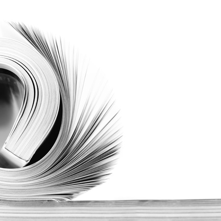 research education: Rolled magazine on white background. B&W image.