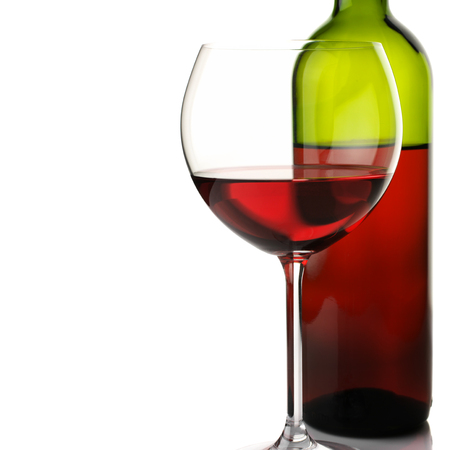 stemware: Glass and bottle of red wine on white background.