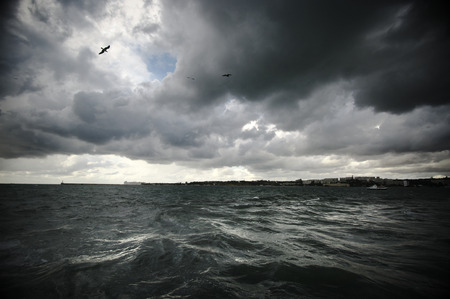 Dark stormy clouds and sea. photo