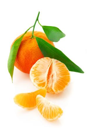 Fresh whole tangerine and slices isolated on white . photo