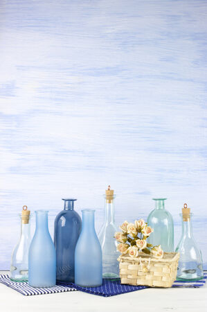 Collection of decorative bottles on blue wooden. photo
