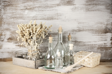 country life: Glass bottles and dry flowers on rustic wooden. Stock Photo