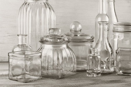 Collection of empty various glassware on vintage wooden background. photo