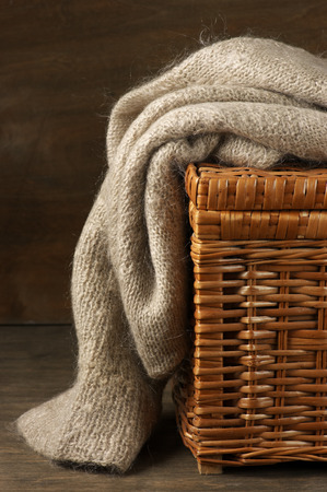 mohair: Fluffy knitted sweater on wicker basket.