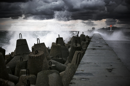 Storm surf breaking on breakwater. photo