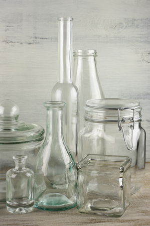 Collection of empty various glassware on vintage wooden. photo
