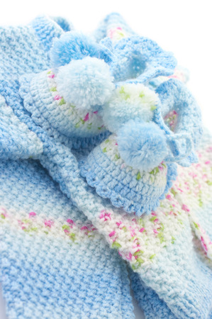 baby's bootee: Handmade babys knitted clothes close-up.