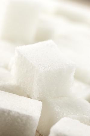 refine: Close-up of sugar cubes. Shallow DOF.