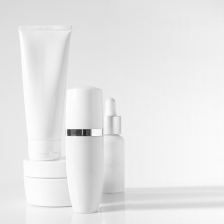 cosmetic products: Cosmetic antiaging line on light background. High key.