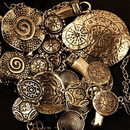 Collection of golden ethnic jewelry on black background. photo