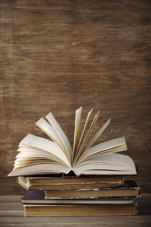 Stack of old books on wooden background. photo