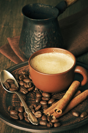Coffee cup, beans, cinnamon and cezve. photo
