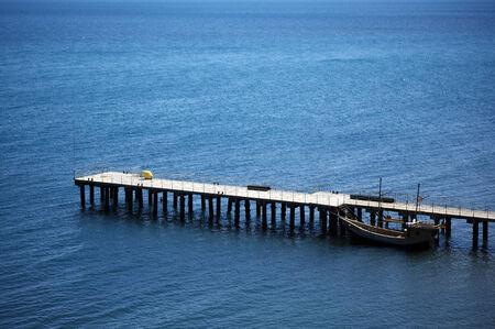 Sailing boat at wooden pier. photo