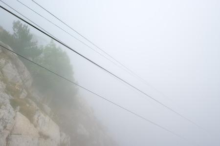 Cableway in tight fog. Crimea, Ai-Petri. photo