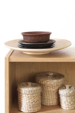 Wooden shelf with decorative elements on white background. photo