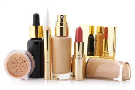 Cosmetic set: liquid foundation, concealer, mineral powder, lipstick and face serum isolated on white background. photo
