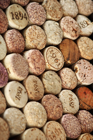 Stack of assorted wine corks close-up. photo