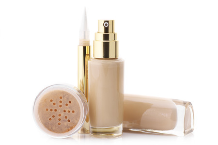 Two glass bottle of cosmetic liquid foundation, corrective concealer and loose mineral face powder isolated on white background. photo