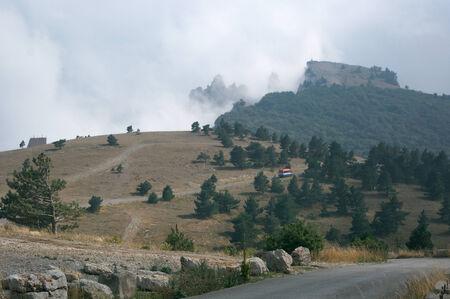 Mountain top in fog. Crimea, Ai-Petri plateau. photo