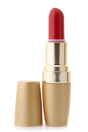 gold facial: Red lipstick in golden container isolated on white background. Stock Photo