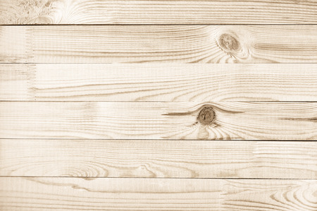 boarded: Natural knotted pine wood plank texture background.