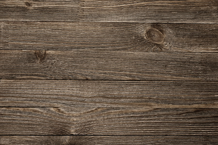 Natural knotted brown weathered wood plank texture background. photo