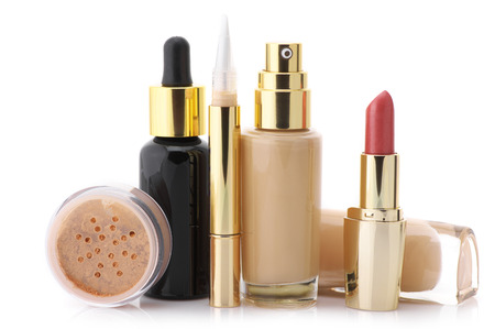 Cosmetic set: liquid foundation, concealer, mineral powder, lipstick and face serum isolated on white background.