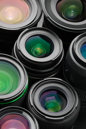 multilayer: Close-up of many various photo lenses with colorful antireflection multi-layer coating.