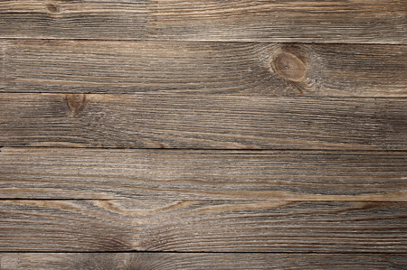 Natural knotted brown weathered wood plank texture background.