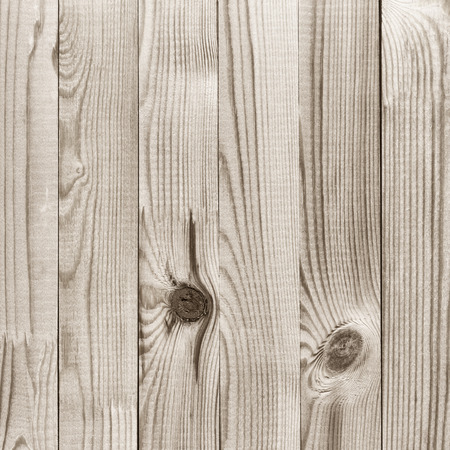 Natural knotted pine wood plank texture background. Filtered image.