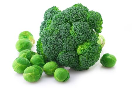 Fresh broccoli and brussels sprouts isolated on white background.